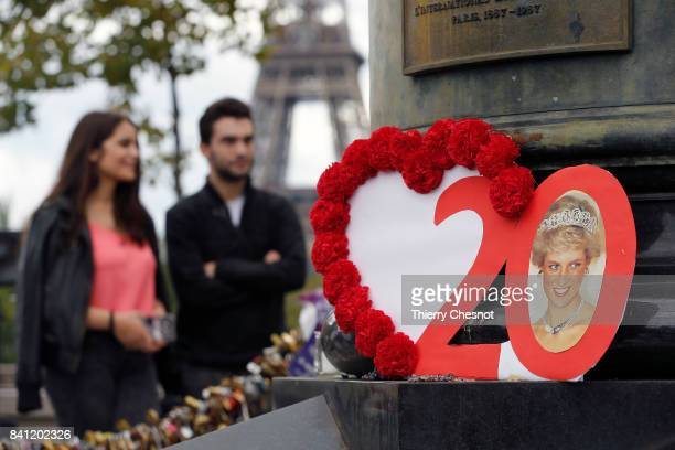 A red heartshaped bouquet of flowers is displayed in front of the Flame of Liberty statue to pay homage to Diana Princess of Wales on August 31 2017...