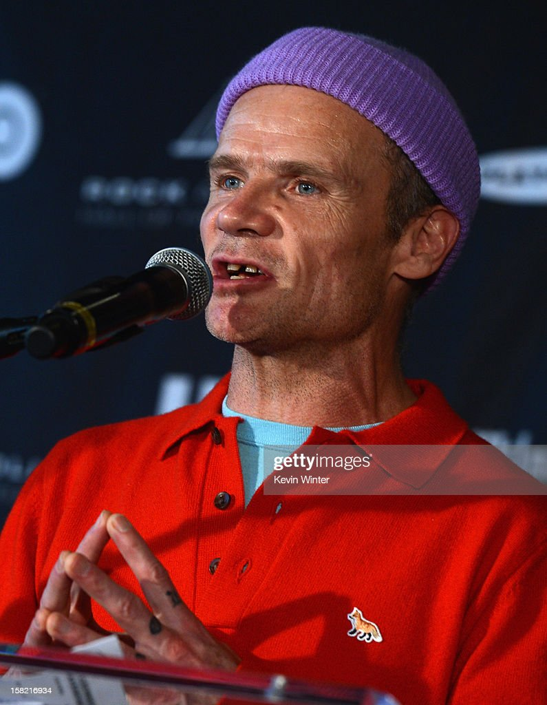 Red Hot Chili Peppers bassist <a gi-track='captionPersonalityLinkClicked' href=/galleries/search?phrase=Flea+-+Musician&family=editorial&specificpeople=213900 ng-click='$event.stopPropagation()'>Flea</a> speaks at the press conference to announce the Rock and Roll Hall of Fame 2013 Inductees at Nokia Theatre L.A. Live on December 11, 2012 in Los Angeles, California.