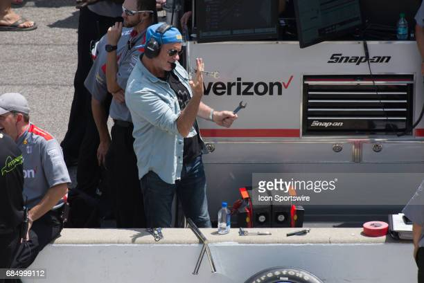 Red Hot Chili Peppers drummer Chad Smith using wrenches as drum sticks in the pit box of Will Power during the fourth day of practice for the 101st...