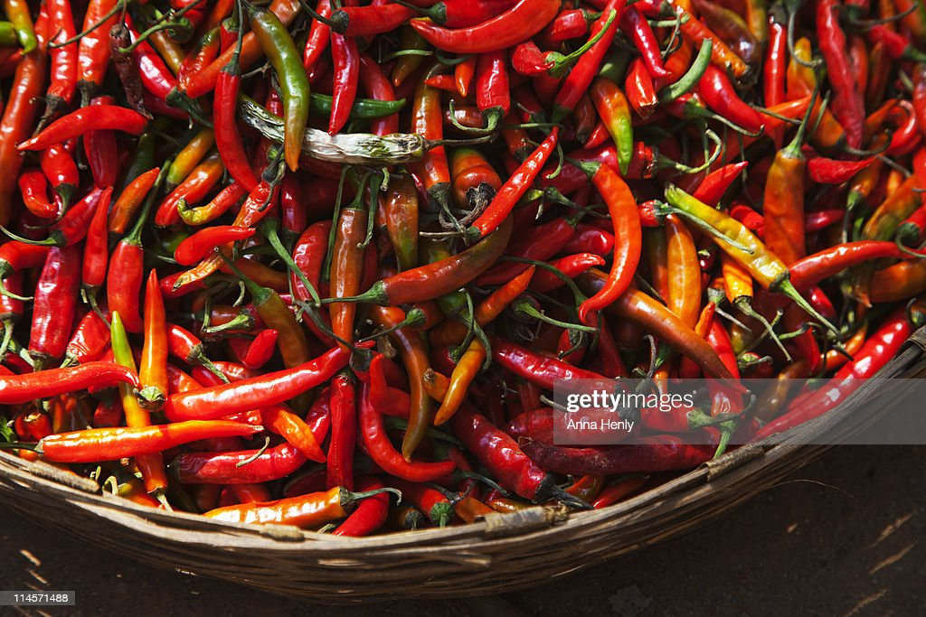 Red hot chili peppers in basket : Stock Photo