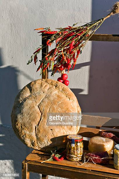 Red hot dry peppers and the famous bread of Monte Sant'Angelo on sale, Gargano, Foggia, Apulia, Italy, Europe