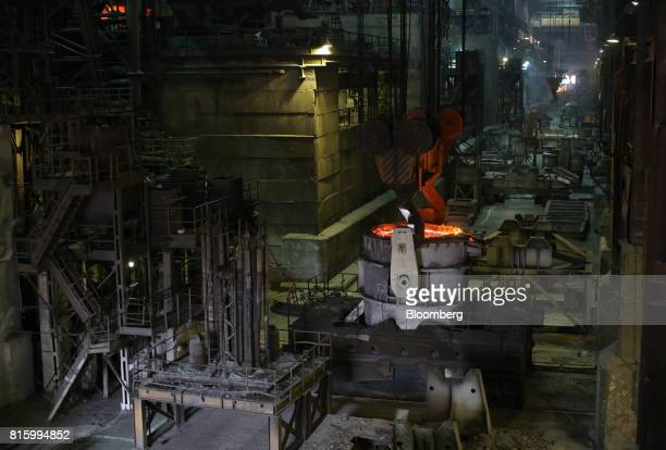 Red hot molten steel sits in an arc furnace in the steel smelting shop at the Oskol Elektrometallurgical Plant steel mill operated by...