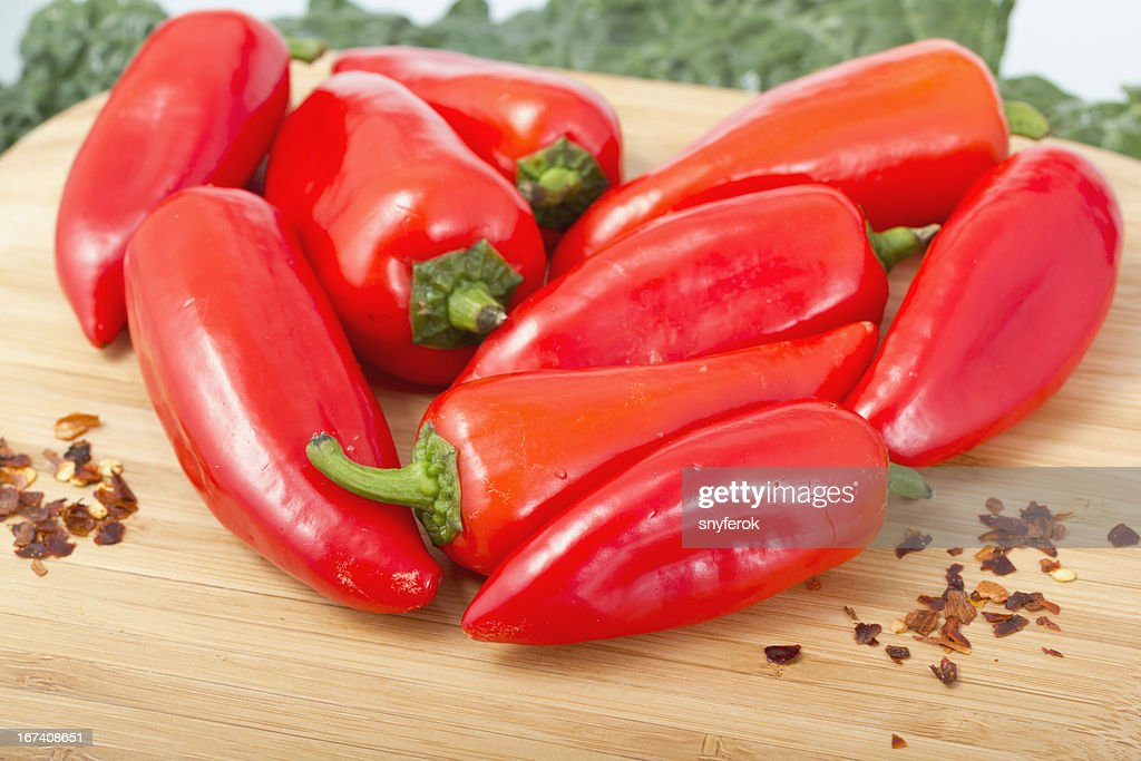 Red hot peppers on wooden cutting board. : Stock Photo