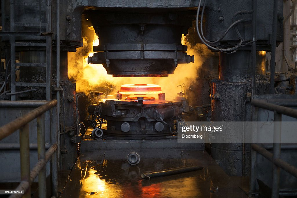 A red hot steel wheel for railway rolling stock is seen on the pressing machine at the Interpipe LLC steel plant in Dnipropetrovsk, Ukraine, on Wednesday, Jan. 30, 2013. Ukraine's Interpipe Group, owned by billionaire Victor Pinchuk, opened a $700 million electric steel mill in Dnipropetrovsk with an annual output capacity of 1.32 million tons of steel for its seamless pipe production. Photographer: Vincent Mundy/Bloomberg via Getty Images