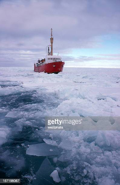 A red ice breaking ship breaking up frozen water