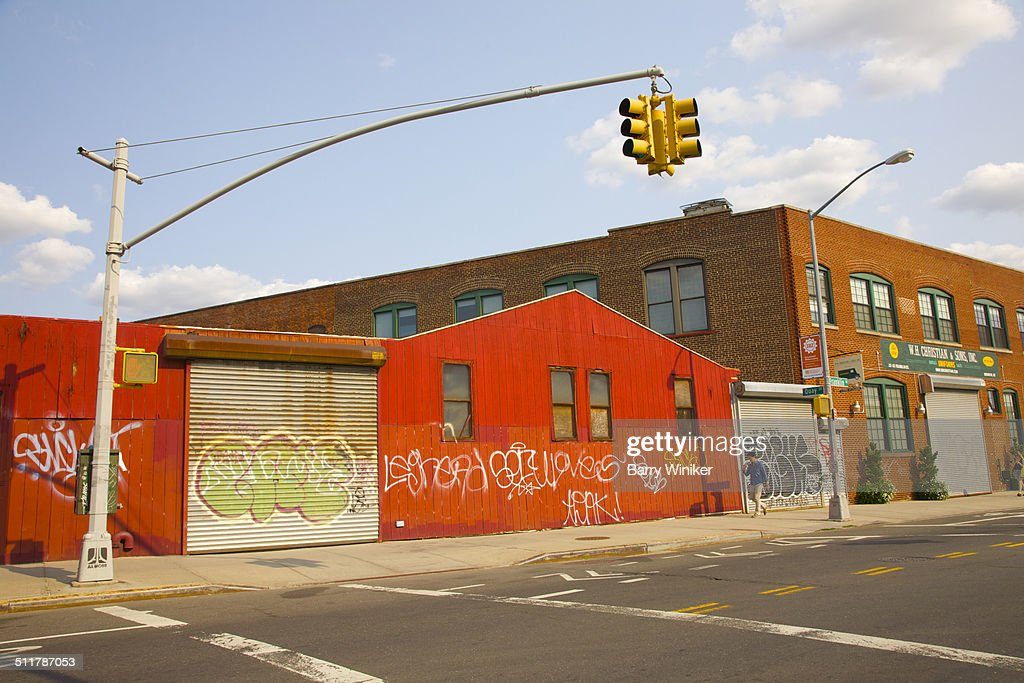 Red industrial buildings in changing neighborhood
