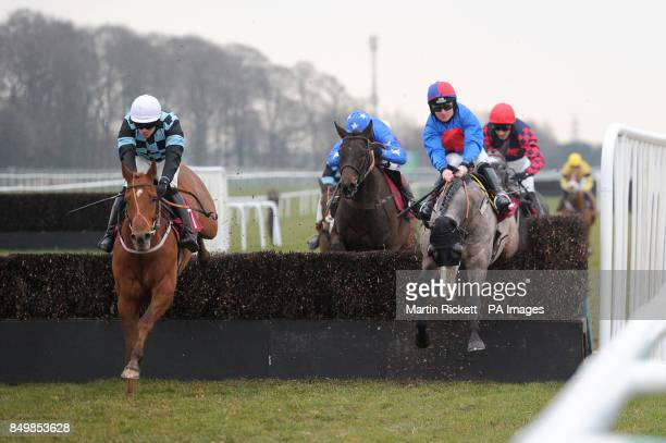 Red Inka ridden by Danny Cook jumps the final fence to win the Bravo Inns Fixed Brush Handicap Hurdle with White Fusion during the Molson Coors...