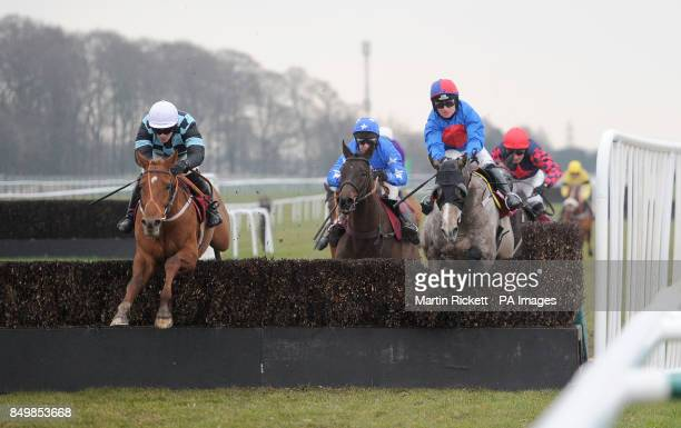 Red Inka ridden by Danny Cook jumps the final fence to win the Bravo Inns 'Fixed Brush' Handicap Hurdle with White Fusion during the Molson Coors...