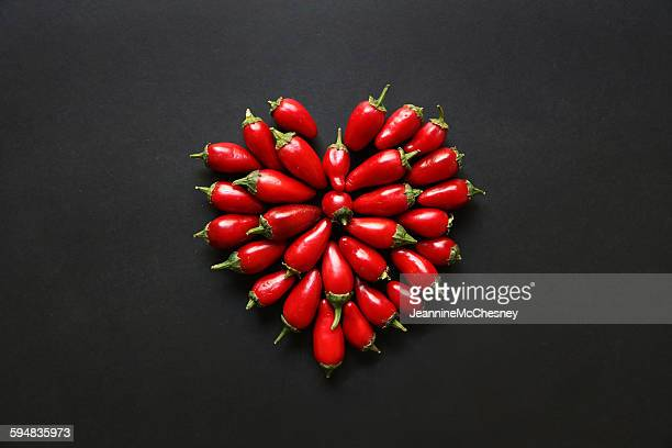 Red jalapeno peppers in a heart shape