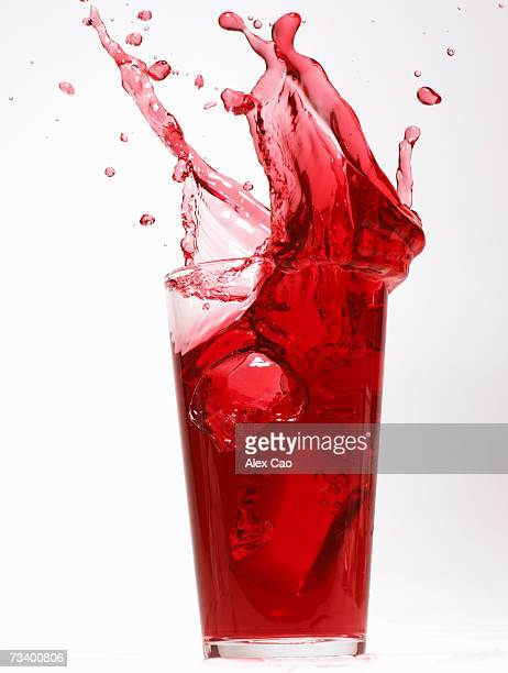 Red juice spilling from glass