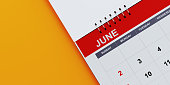 Red June 2019  calendar on yellow background. Horizontal composition with copy space. Calendar and reminder concept.