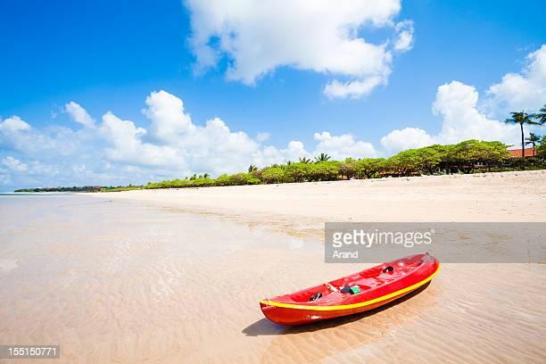 Red kayak on beach