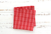 red kitchen cloth on white vintage wooden table. copy space