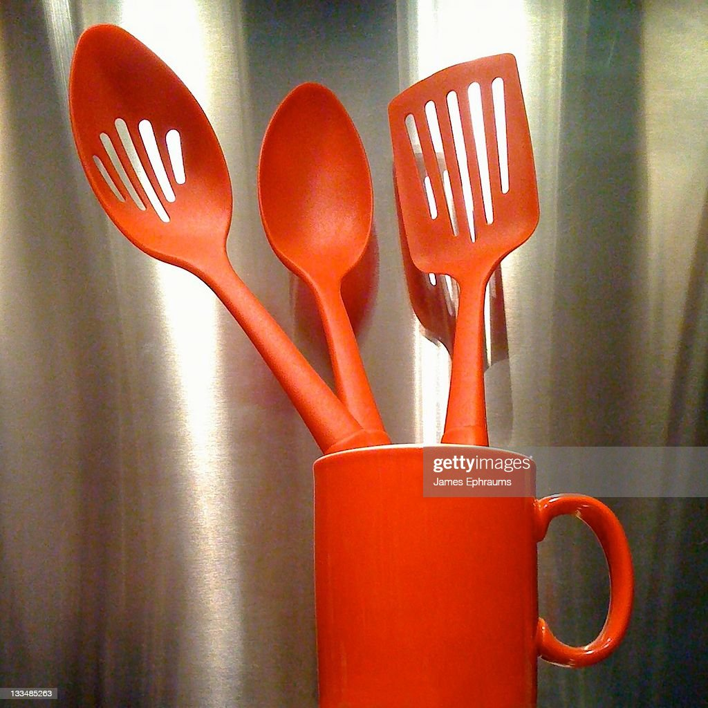 red kitchen utensils and red mug stock photo | getty images