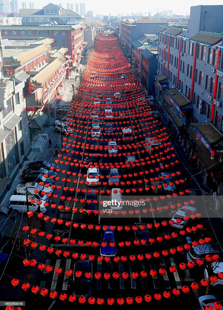 Red lanterns hang across a street on January 25, 2014 in Shenyang, China. Chinese people are preparing for the Spring Festival, the year of horse, which will fall on January 31 according to Chinese calendar.