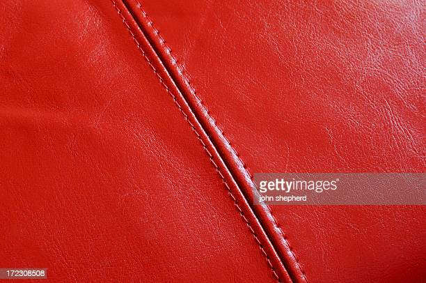 red leather background with stitching