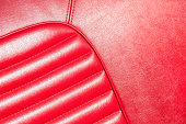luxurious red leather classic car interior closeup in sunlight