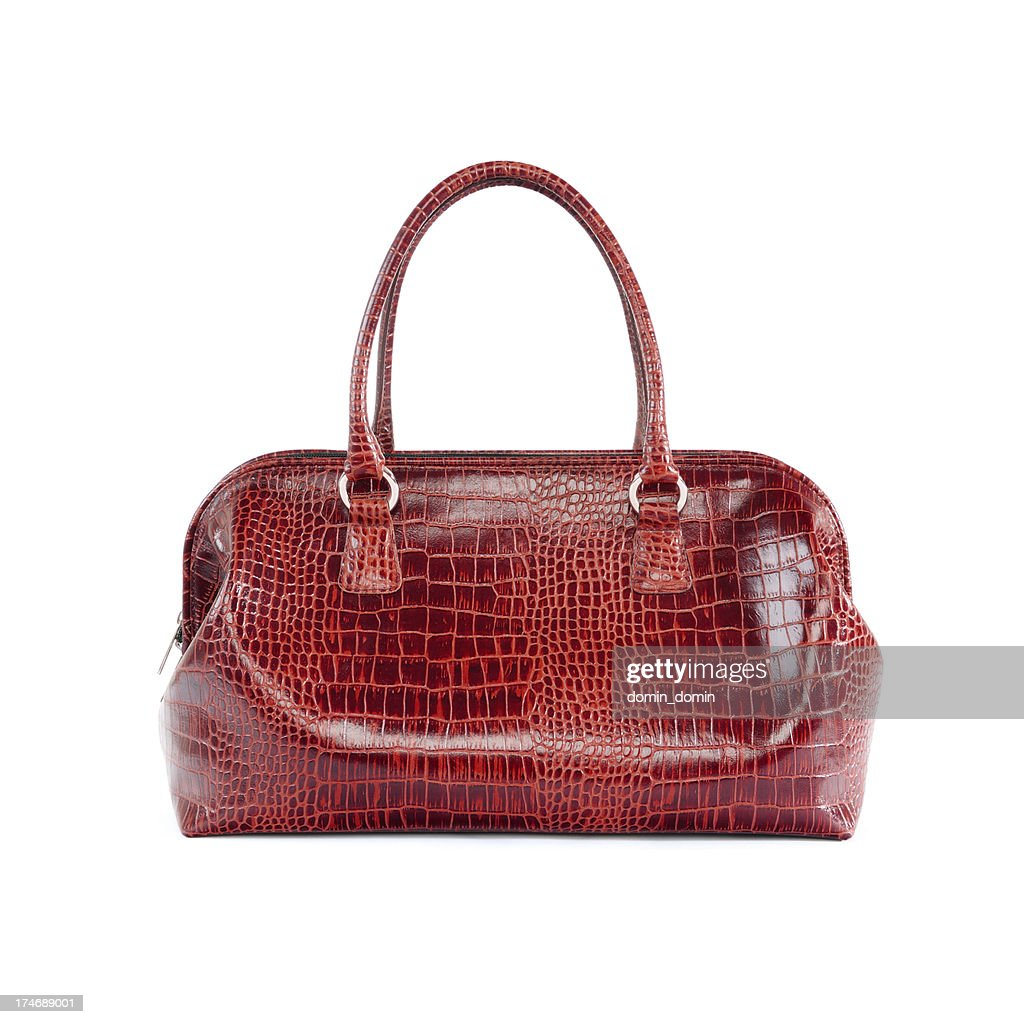 Red leather woman handbag isolated on white