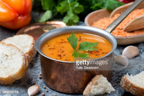 red lentil soup with pepper and spices in copper saucepan : Stock Photo