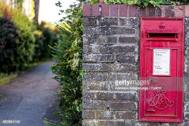 Red Letter Box On Stone Wall