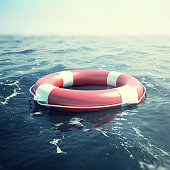 Red lifebuoy floating in the sea, 3d illustration