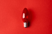 Red Light bulb on red background. Top view. Business idea concept.