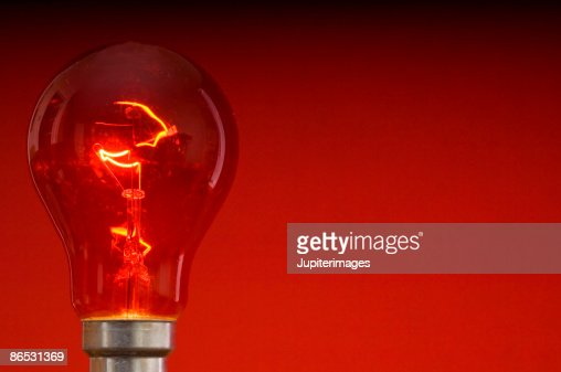 Red light bulb : Stock Photo