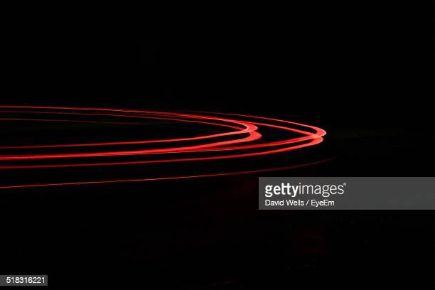 Red Light Trails Over Black Background