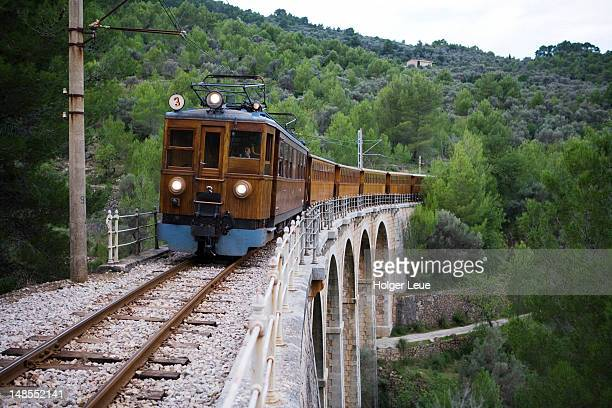Red Lightning Palma to Soller train crosses bridge.
