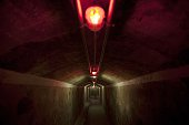 Red lights illuminate an underground gallery of a Spanish civil war era bomb shelter in Almeria on May 23 2016 There were 67 entrances spread out...