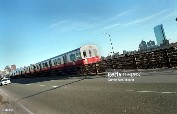 Red Line subway car known as the T in Boston crosses the Charles River March 12 2001 into Cambridge MA Boston's subway system the oldest in the...