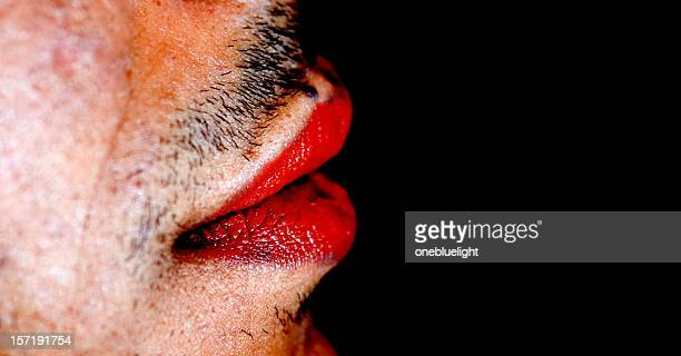 Red lipstick on man's lips