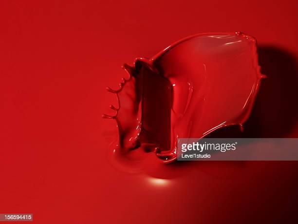 Red liquid splashing