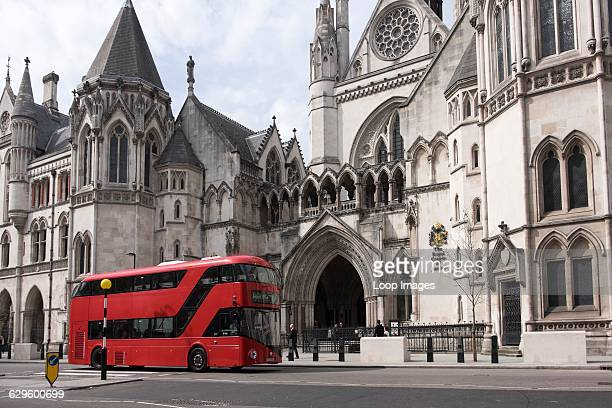 Red London bus outside The Royal Courts of Justice The Strand England