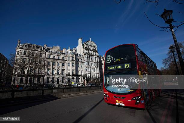 A red London bus passes a row of buildings including 139 Piccadilly second left in the Mayfair district of London UK on Tuesday Feb 17 2015...