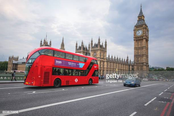 Red London Bus with Houses of Parliament and Big Ben