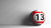 Red lottery ball with number 13 on grey background, three-dimensional rendering, 3D illustration