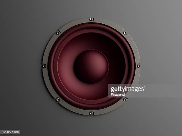 Red loudspeaker on grey background