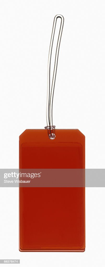 Red luggage, price, gift, I.D. or merchandise tag  : Stock Photo