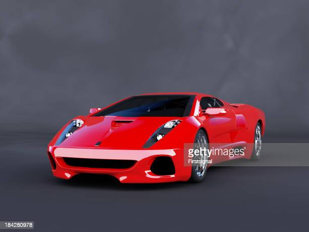 Red luxury car on angle parked on dark background
