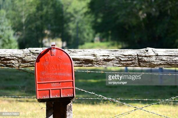 USA, Red mailbox on fencepost