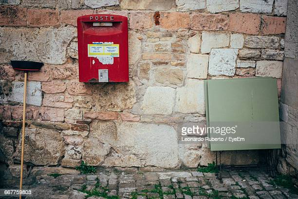 Red Mailbox On Stone Wall