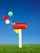 Red mailbox with balloons