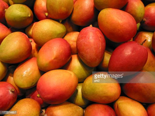 Red Mangoes on Market Stall