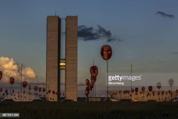 Red masks part of the activist group Rio de Paz's art installation of masks symbolizing Brazil's President Michel Temer and 594 Brazilian lawmakers...