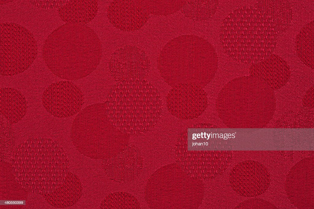 Red material in circles, a background : Stock Photo