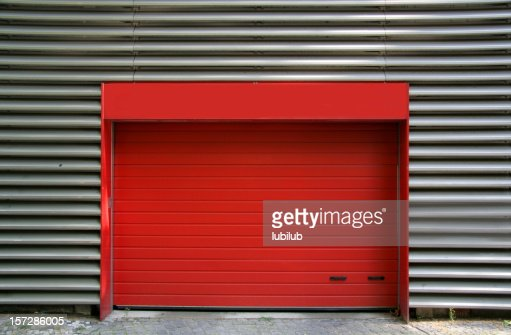 Red metal door and corrugated iron to garage,Berlin Germany