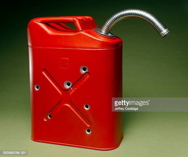 Red metal gas can with bullet holes