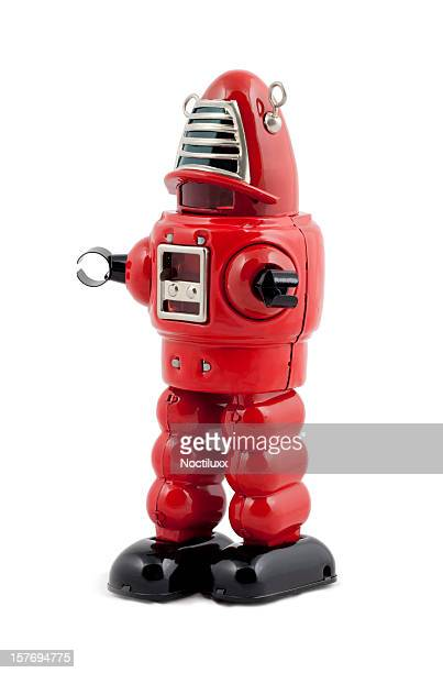 Red metal toy robot isolated