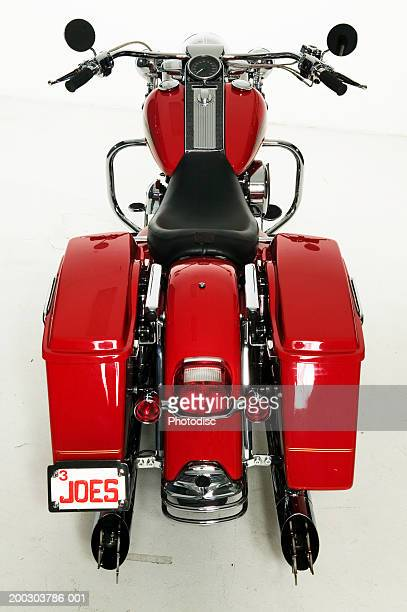 Red motorcycle parked in studio, elevated view